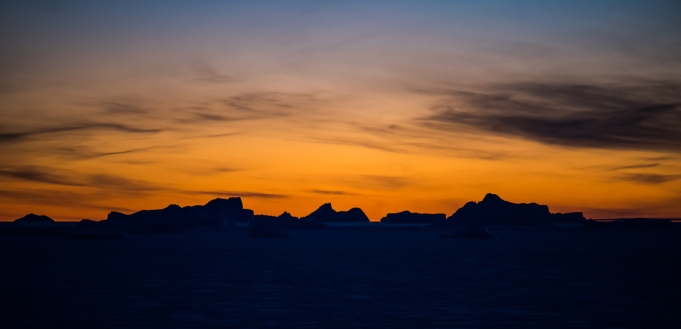 Ice bergs silhouetted against the sunset
