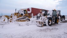 Blizzed in heavy machinery in front of the workshops