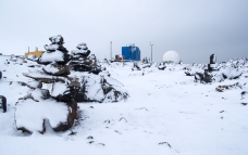 Snow covered rock cairns north of the Met building