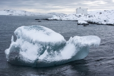 Small ice berg grounded close to the shore
