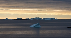 Sunset over a iceberg in front of the station