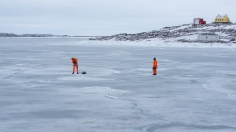 Lötter and Tony out on the ice taking measurements