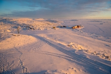 Pastel colours of sunset over snow covered landscape